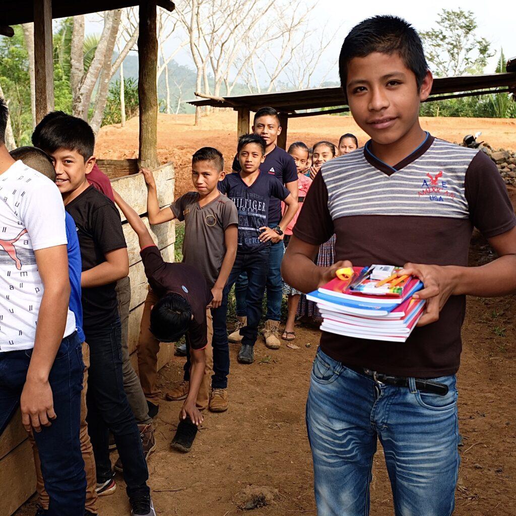 Guatemalan boy with school materials
