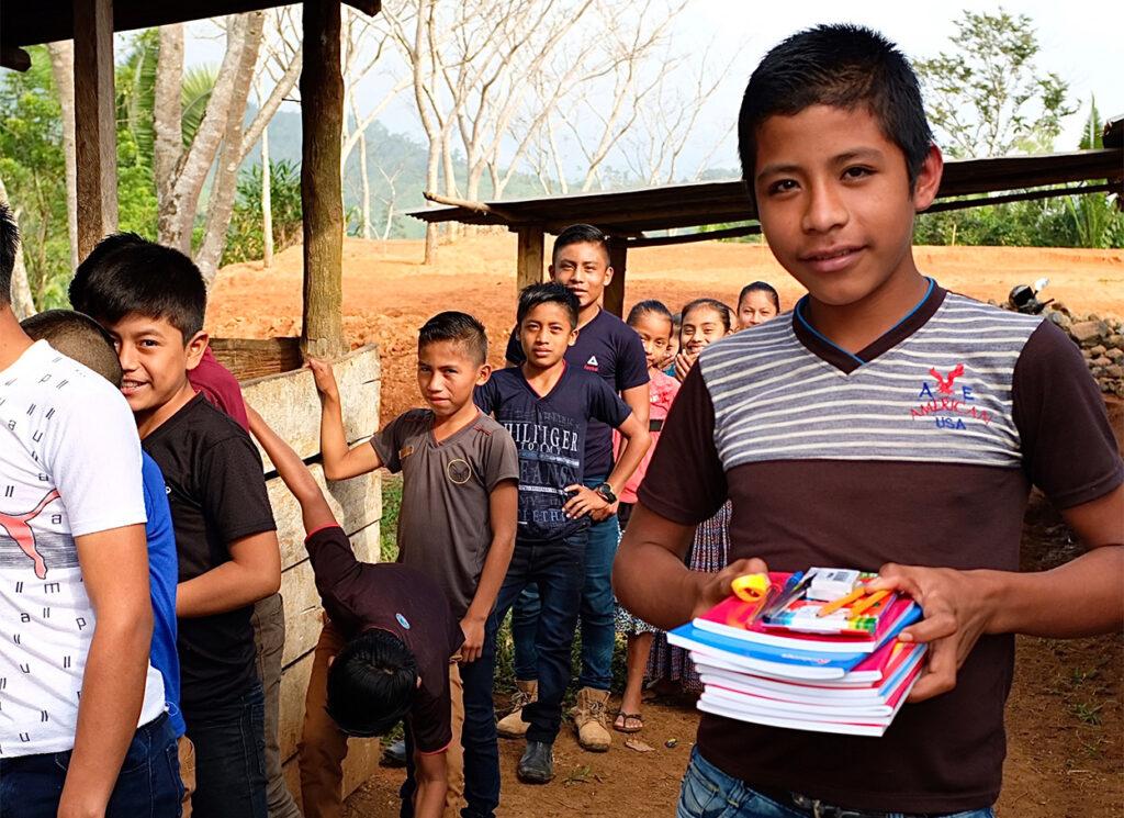 Indigenous Boy With School Supplies