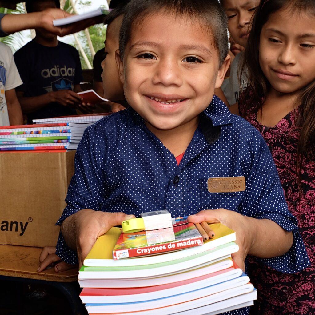Happy Little Boy with School Supplies