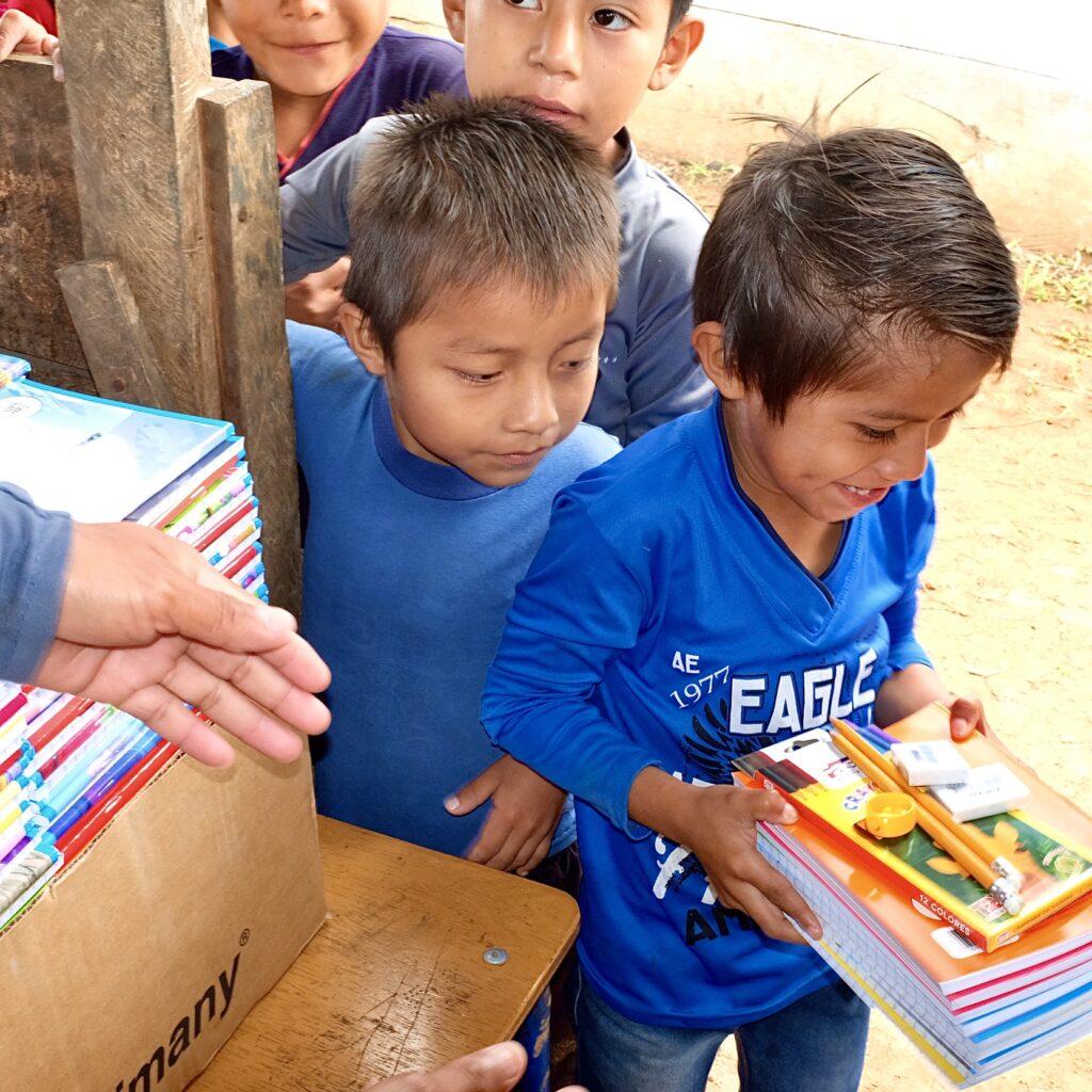 Boy Receives School Supplies
